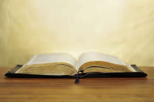 Old bible on golden background